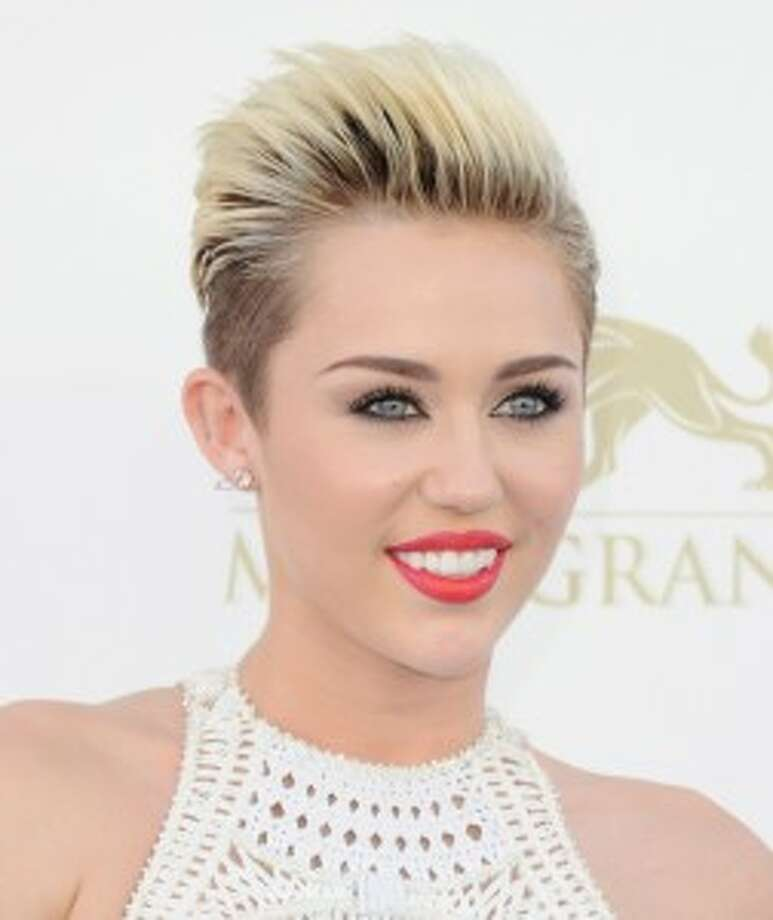 "Singer/actress Miley Cyrus debuted her first scent as Disney idol ""Hannah Montana."""