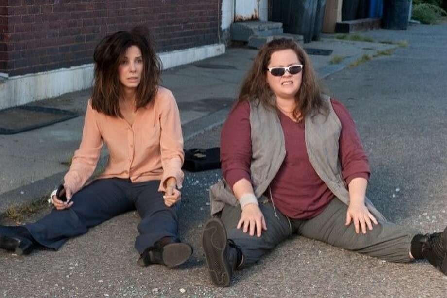 "Sandra Bullock (left) and Melissa McCarthy play detectives who clash in the buddy picture ""The Heat."" Photo: 20th Century Fox"