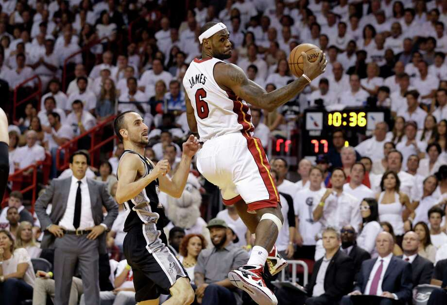 Miami Heat's LeBron James (6) prepares to pass the ball as San Antonio Spurs' Manu Ginobili of Argentina, left, during the first half of Game 2 in the NBA Finals basketball game,  Sunday, June 9, 2013 in Miami. (AP Photo/Lynne Sladky) Photo: Lynne Sladky, STF / AP