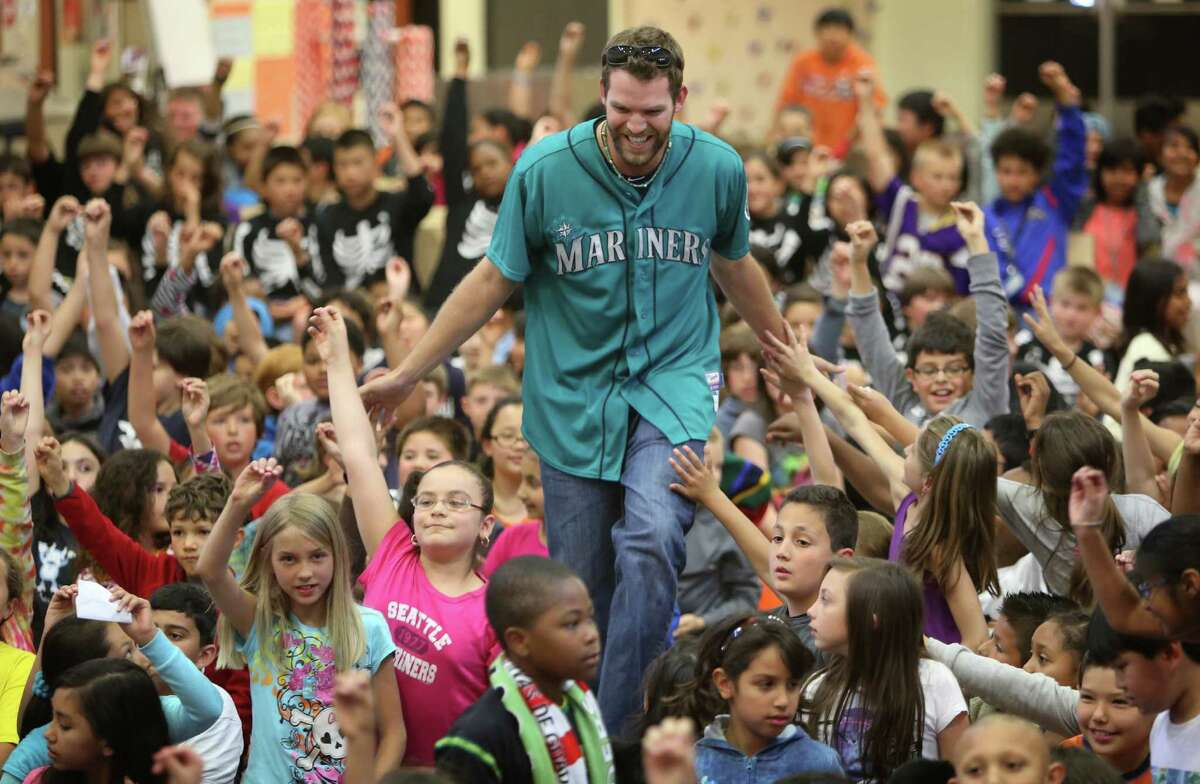 Mariners player Tom Whilhelmsen high-fives students at Cedarhurst Elementary School in Burien during the Mariners' annual D.R.E.A.M. Team assembly. Players visited elementary schools in the Seattle area on Tuesday to talk about the D.R.E.A.M. principles: Drug free, respect for yourself and others, Education through reading, Attitude and Motivation to achieve your dreams.