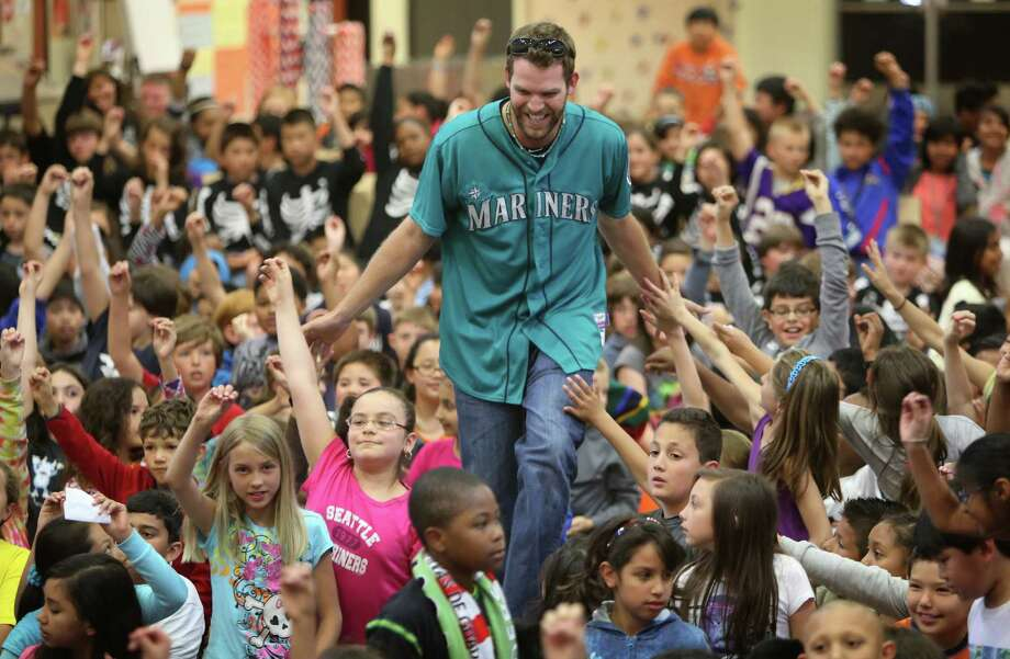 Mariners player Tom Whilhelmsen high-fives students at Cedarhurst Elementary School in Burien during the Mariners' annual D.R.E.A.M. Team assembly. Players visited elementary schools in the Seattle area on Tuesday to talk about the D.R.E.A.M. principles: Drug free, respect for yourself and others, Education through reading, Attitude and Motivation to achieve your dreams. Photo: JOSHUA TRUJILLO, SEATTLEPI.COM / SEATTLEPI.COM