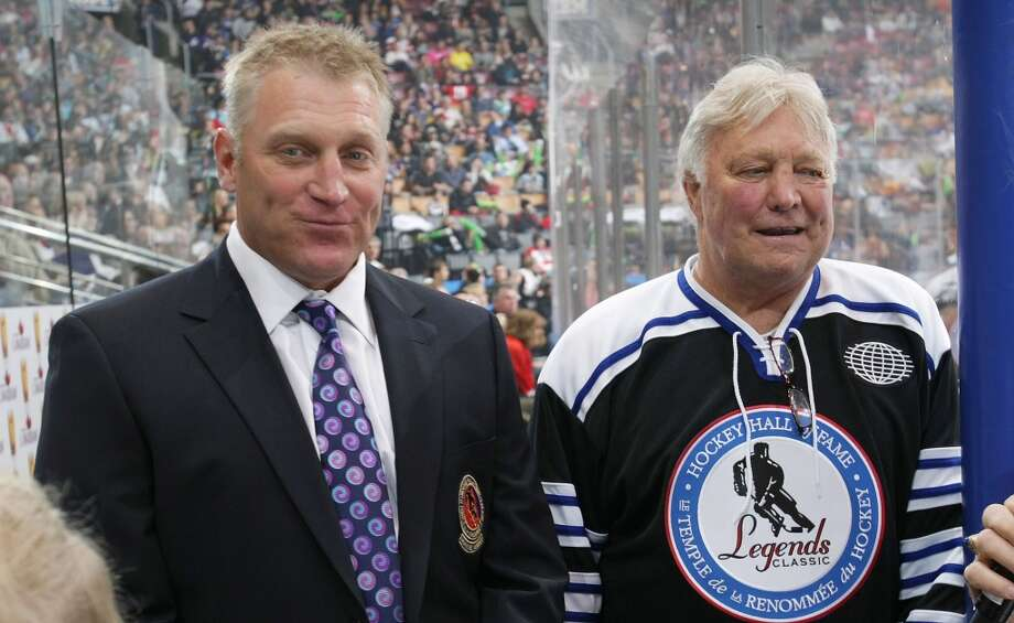 Bobby and Brett Hull — Dad Bobby was one of the greatest left wings in NHL history, and son Brett followed in his skates with 741 career goals, good for third all-time. Photo: Bruce Bennett, Getty Images