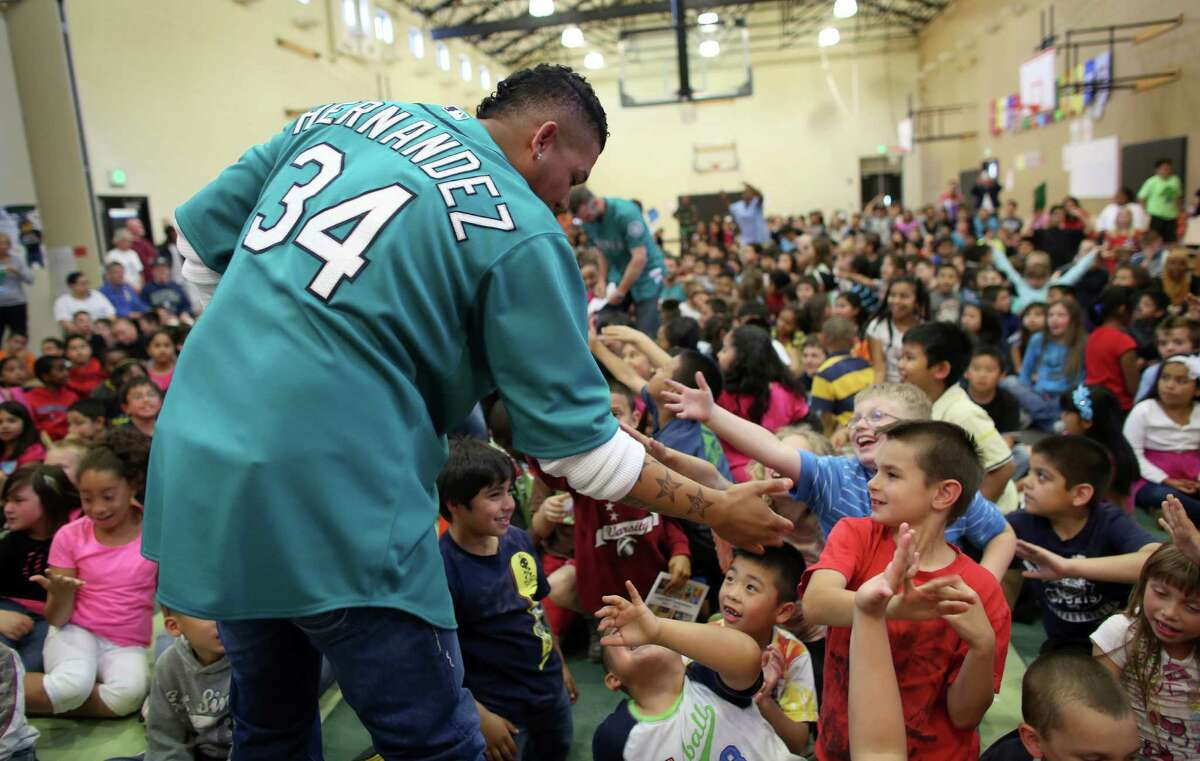 Mariners player Felix Hernandez has a laugh at Cedarhurst Elementary School in Burien during the Mariners' annual D.R.E.A.M. Team assembly. Players visited elementary schools in the Seattle area on Tuesday to talk about the D.R.E.A.M. principles: Drug free, respect for yourself and others, Education through reading, Attitude and Motivation to achieve your dreams.