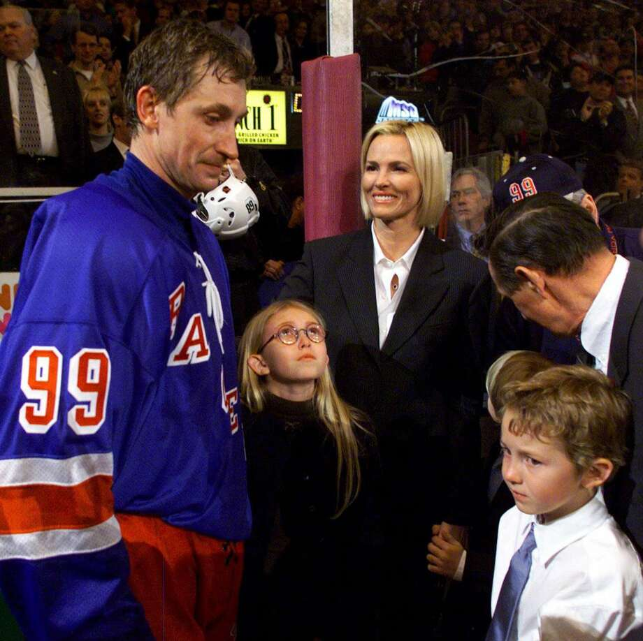 Wayne Gretzky — The greatest hockey player who ever lived looks with some concern at his kids... Photo: PAUL CHIASSON, AP / CP