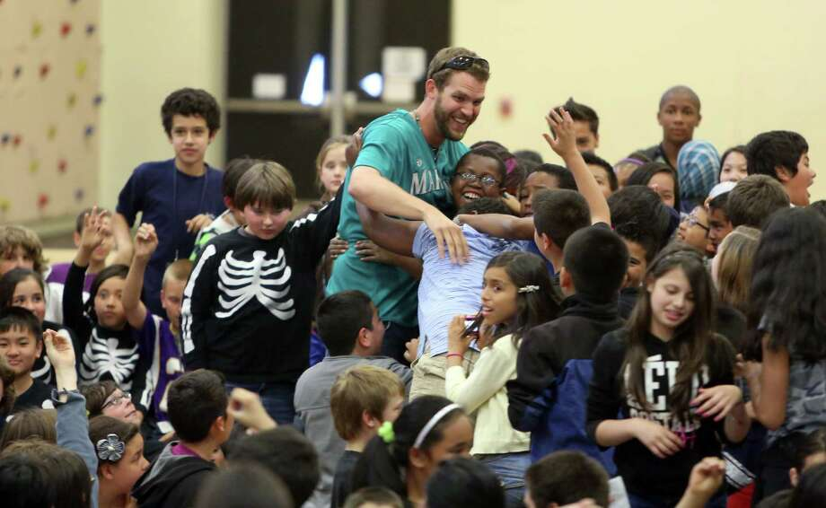 Mariners player Tom Whilhelmsen is mobbed by enthusiastic students at Cedarhurst Elementary School in Burien during the Mariners' annual D.R.E.A.M. Team assembly. Players visited elementary schools in the Seattle area on Tuesday to talk about the D.R.E.A.M. principles: Drug free, respect for yourself and others, Education through reading, Attitude and Motivation to achieve your dreams. Photo: JOSHUA TRUJILLO, SEATTLEPI.COM / SEATTLEPI.COM