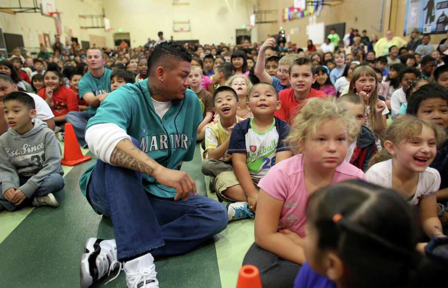 Mariners player Felix Hernandez sits with students at Cedarhurst Elementary School in Burien during the Mariners' annual D.R.E.A.M. Team assembly. Players visited elementary schools in the Seattle area on Tuesday to talk about the D.R.E.A.M. principles: Drug free, respect for yourself and others, Education through reading, Attitude and Motivation to achieve your dreams. Photo: JOSHUA TRUJILLO, SEATTLEPI.COM / SEATTLEPI.COM