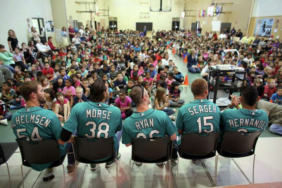 From left, Mariners players Tom Whilhelmsen, Michael Morse, Brendan Ryan, Kyle Seager and Felix Hernandez take their seats at Cedarhurst Elementary School in Burien for the Mariners' annual D.R.E.A.M. Team assembly. Players visited elementary schools in the Seattle area on Tuesday to talk about the D.R.E.A.M. principles: Drug free, respect for yourself and others, Education through reading, Attitude and Motivation to achieve your dreams. Photo: JOSHUA TRUJILLO, SEATTLEPI.COM / SEATTLEPI.COM