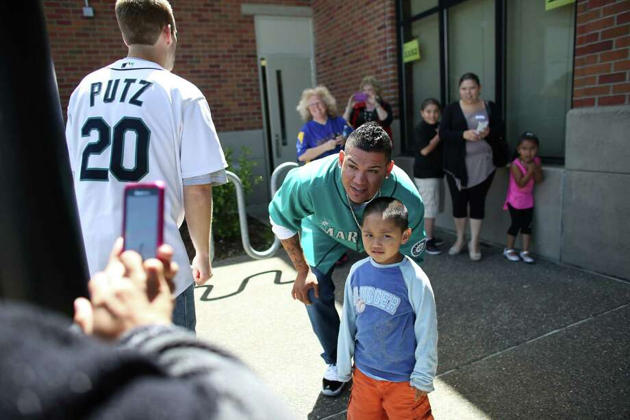 Mariners player Felix Hernandez poses for a photo at Cedarhurst Elementary School in Burien during the Mariners' annual D.R.E.A.M. Team assembly. Players visited elementary schools in the Seattle area on Tuesday to talk about the D.R.E.A.M. principles: Drug free, respect for yourself and others, Education through reading, Attitude and Motivation to achieve your dreams. Photo: JOSHUA TRUJILLO, SEATTLEPI.COM / SEATTLEPI.COM