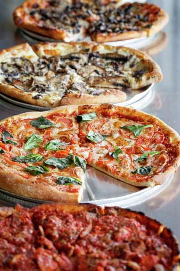 The Queen Margherita and other pizzas at Pizza L'Vino. Photo: Michael Paulsen, Houston Chronicle / © 2013 Houston Chronicle