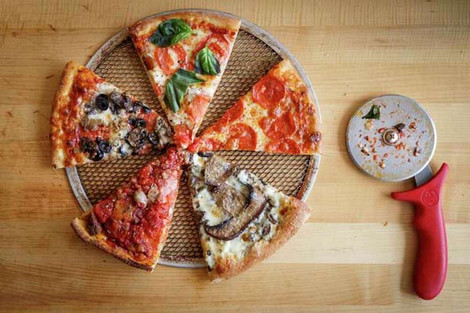 The Most Ordered, left to right, Queen Margherita, Ultimate Pepperoni, Magic Mushroom and Meathead pizza slices at Pizza L'Vino. Photo: Michael Paulsen, Houston Chronicle / © 2013 Houston Chronicle