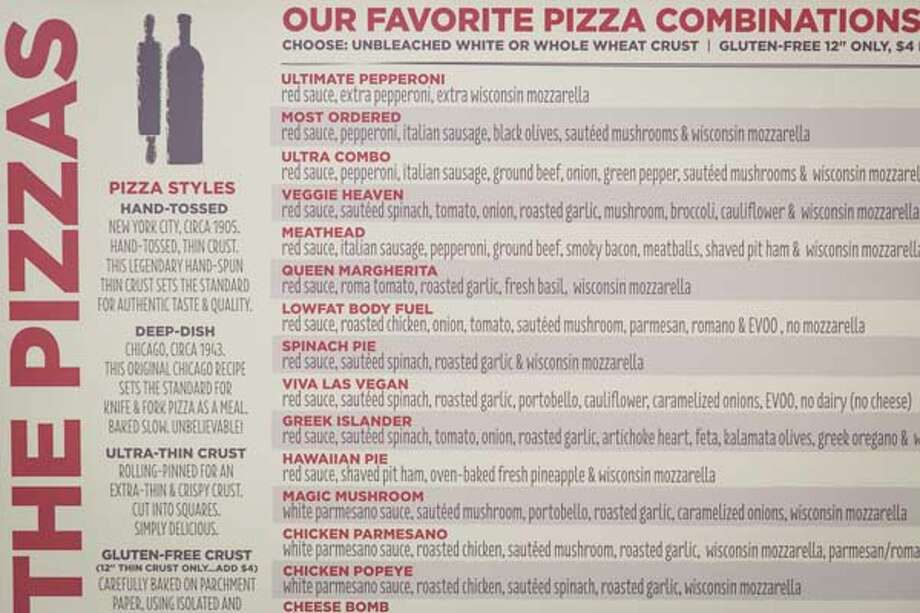 The menu at Pizza L'Vino, a pizza restaurant that offers home delivery and takeout for pizza, beer and wine. Photo: Michael Paulsen, Houston Chronicle / © 2013 Houston Chronicle