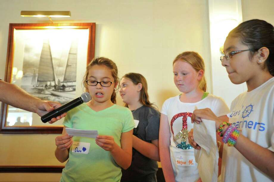 Claire Salerno speaks as her classmates from Stark Elementary School listen from left Mackenzie McInerney, Megan McQuillan and Lubymichelle Chuco, during the graduation festivities for students from the Young Mariners Foundation at the Stamford Yacht Club on Tuesday, June 11, 2013. Photo: Jason Rearick / Stamford Advocate
