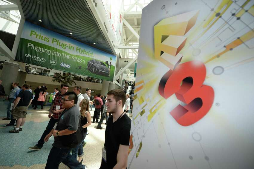 Gaming fans attend the first day of the Electronic Entertainment Expo (E3) in Los Angeles, California, June 11, 2013. The Electronic Entertainment Expo (E3), an annual trade fair for the computer and video games industry, runs from June 11-13. AFP PHOTO / ROBYN BECKROBYN BECK/AFP/Getty Images