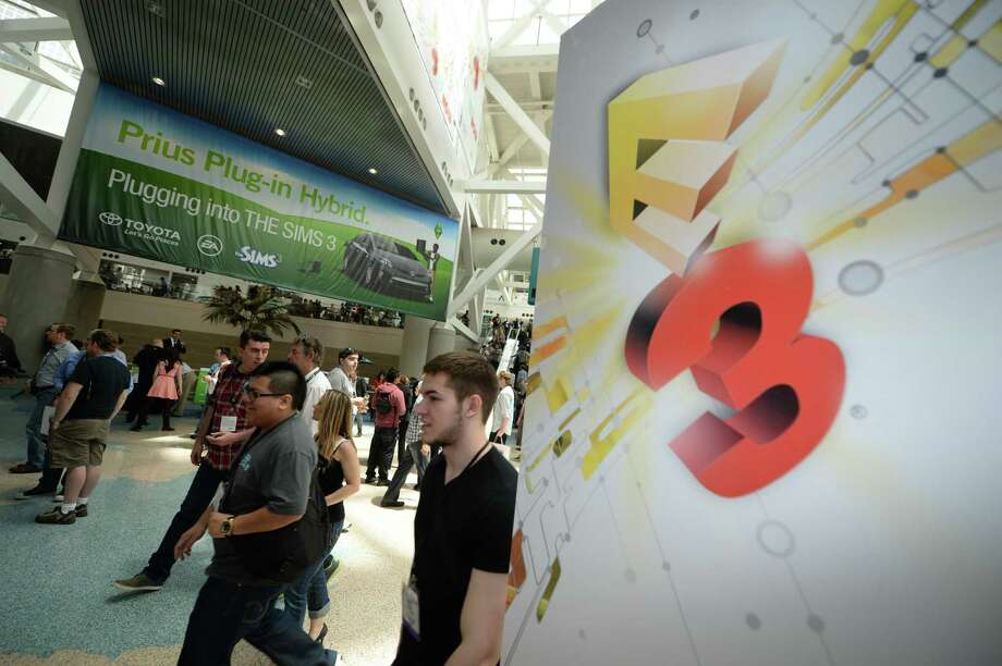 Gaming fans attend the first day of the Electronic Entertainment Expo (E3) in Los Angeles, California, June 11, 2013.   The Electronic Entertainment Expo (E3), an annual trade fair for the computer and video games industry, runs from June 11-13. AFP PHOTO / ROBYN BECKROBYN BECK/AFP/Getty Images Photo: ROBYN BECK, AFP/Getty Images / AFP