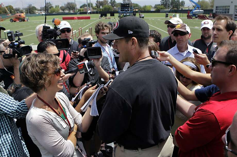 Head coach Jim Harbaugh meets with reporters during a break of the 49ers minicamp in Santa Clara, Calif. on Tuesday, June 11, 2013. Photo: Paul Chinn, The Chronicle