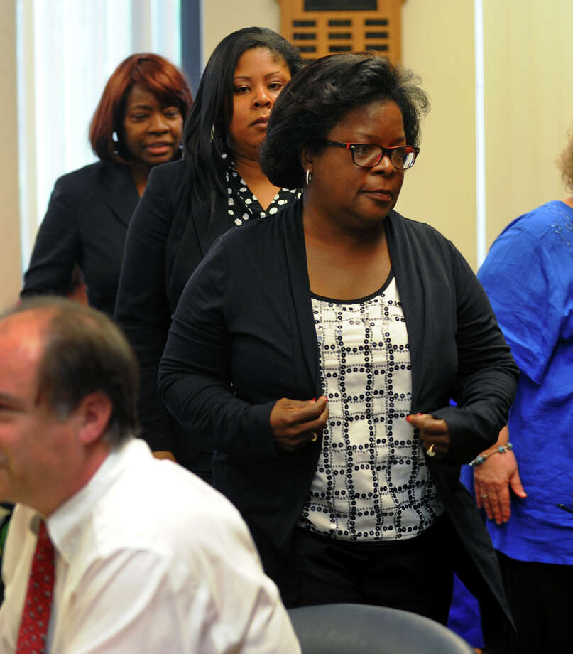 School principal Carmen Perez Dickson leaves a Bridgeport Board of Education disciplinary hearing to confer with her lawyers Atiya Sample and Josephine Miller, in back, at Bridgeport City Hall in Bridgeport, Conn. on Tuesday June 11, 2013. Photo: Christian Abraham / Connecticut Post