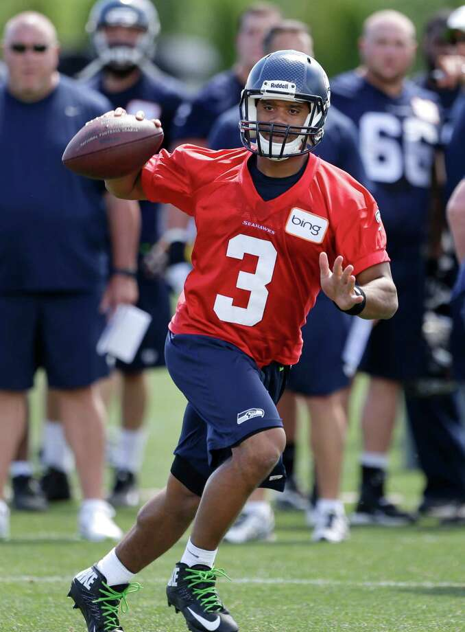 Seattle Seahawks quarterback Russell Wilson scrambles during NFL football minicamp Tuesday, June 11, 2013, in Renton, Wash. Photo: AP