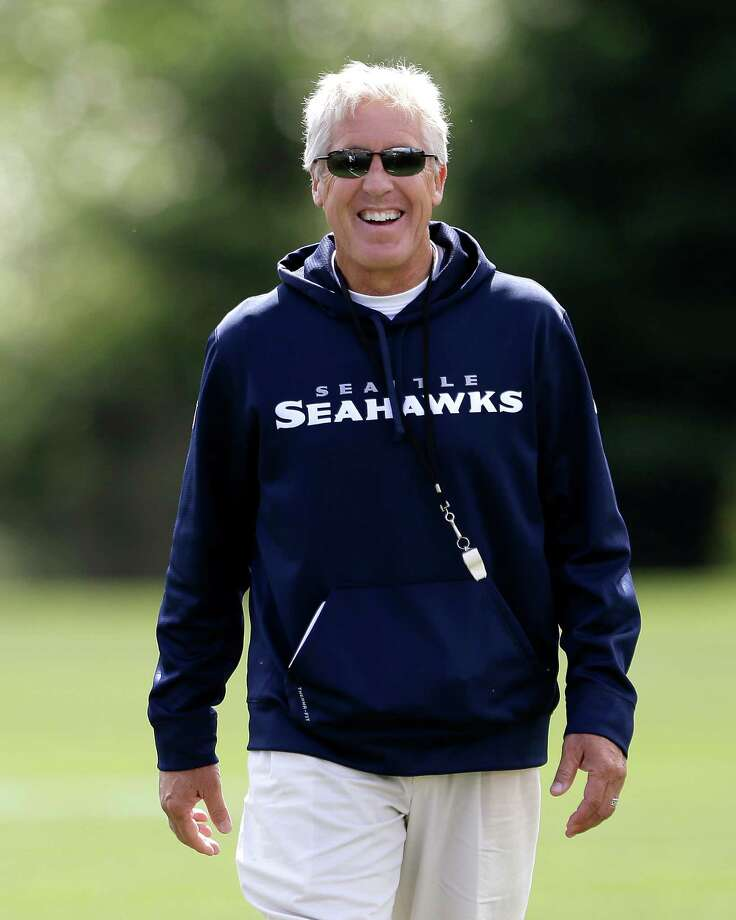 Seattle Seahawks head coach Pete Carroll smiles after a workout at NFL football minicamp Tuesday, June 11, 2013, in Renton, Wash. Photo: AP