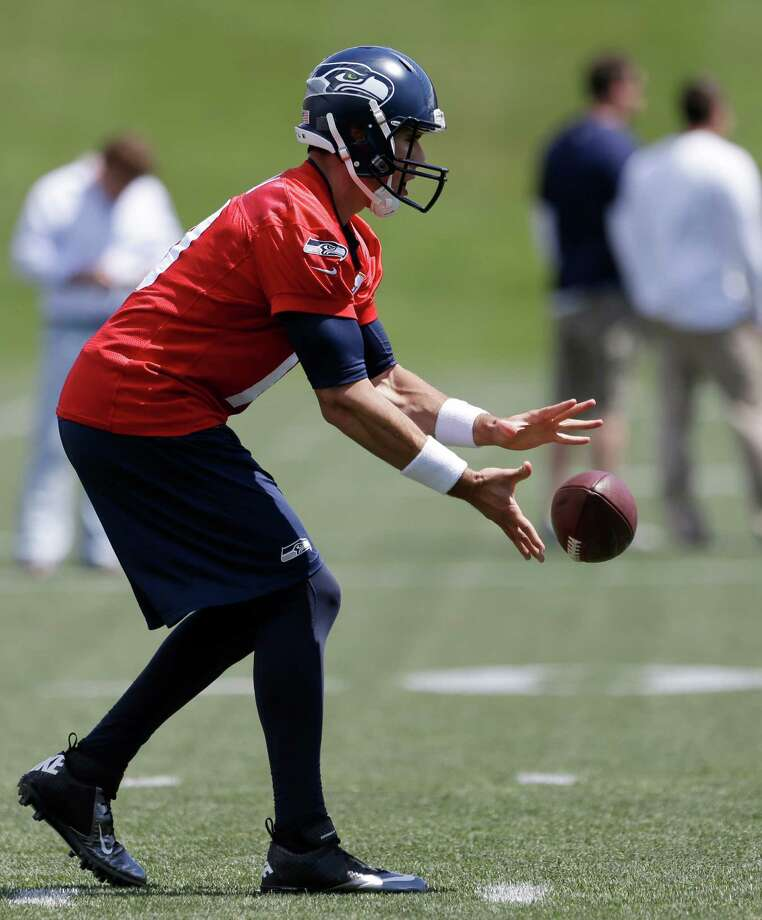 Seattle Seahawks quarterback Brady Quinn takes a snap during NFL football minicamp Tuesday, June 11, 2013, in Renton, Wash. Photo: AP