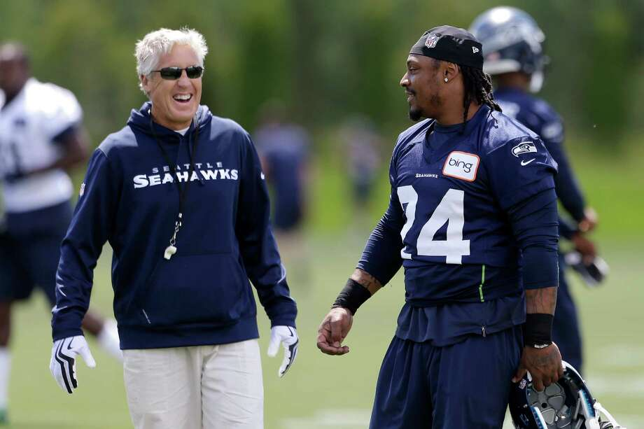 Seattle Seahawks head coach Pete Carroll, left, chats with Marshawn Lynch during NFL football minicamp Tuesday, June 11, 2013, in Renton, Wash. Photo: AP
