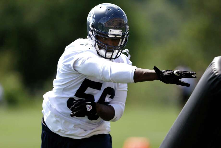 Seattle Seahawks' Cliff Avril runs through a drill during NFL football minicamp Tuesday, June 11, 2013, in Renton, Wash. Photo: AP
