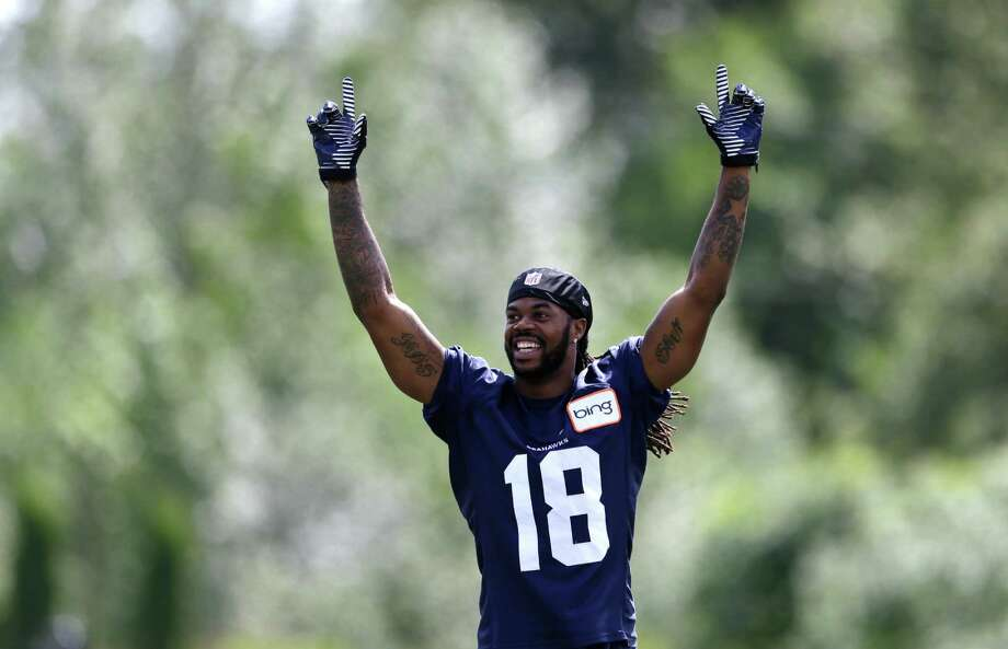 Seattle Seahawks' Sidney Rice playfully raises his arms following an NFL football minicamp Tuesday, June 11, 2013, in Renton, Wash. Photo: AP