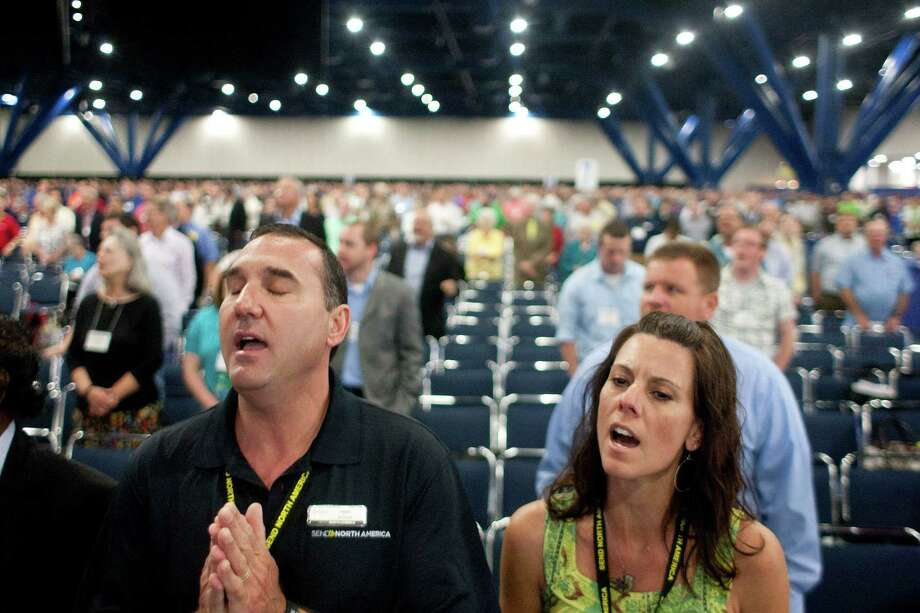 Todd and Barbie Briggs, who pastor a church in Atlanta, Ga., worship during the 2013 Southern Baptist Convention Annual Meeting at the George R. Brown Convention Center Tuesday, June 11, 2013, in Houston. More than 4,500 attended the annual convention. Photo: Johnny Hanson, Houston Chronicle / © 2013  Houston Chronicle