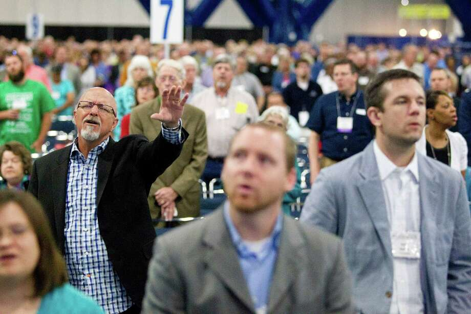 Jon Marks, a worship pastor at First Baptist Orlando in Orlando, Fla., worships during the 2013 Southern Baptist Convention Annual Meeting at the George R. Brown Convention Center Tuesday, June 11, 2013, in Houston. Photo: Johnny Hanson, Houston Chronicle / © 2013  Houston Chronicle