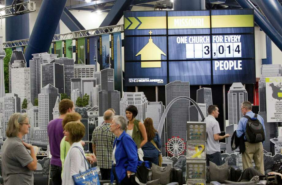 Attendees at the 2013 Southern Baptist Convention Annual Meeting walk through the exhibit area at the George R. Brown Convention Center Tuesday, June 11, 2013, in Houston. Photo: Johnny Hanson, Houston Chronicle / © 2013  Houston Chronicle