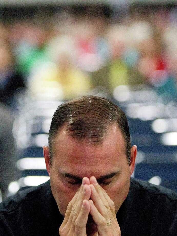 Todd Briggs, who pastors a church in Atlanta, Ga., prays during the 2013 Southern Baptist Convention Annual Meeting at the George R. Brown Convention Center Tuesday, June 11, 2013, in Houston. Photo: Johnny Hanson, Houston Chronicle / © 2013  Houston Chronicle