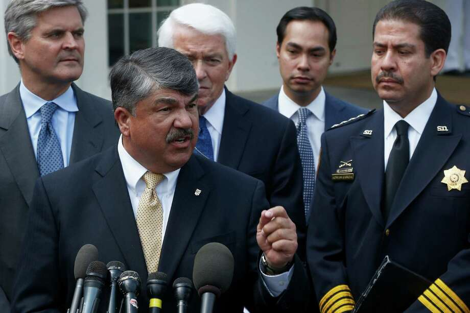 Harris County Sheriff Adrian Garcia, right, and San Antonio Mayor Julian Castro, second from right, listen to AFL-CIO President Richard Trumka on Tuesday at the White House. Photo: Charles Dharapak, STF / AP