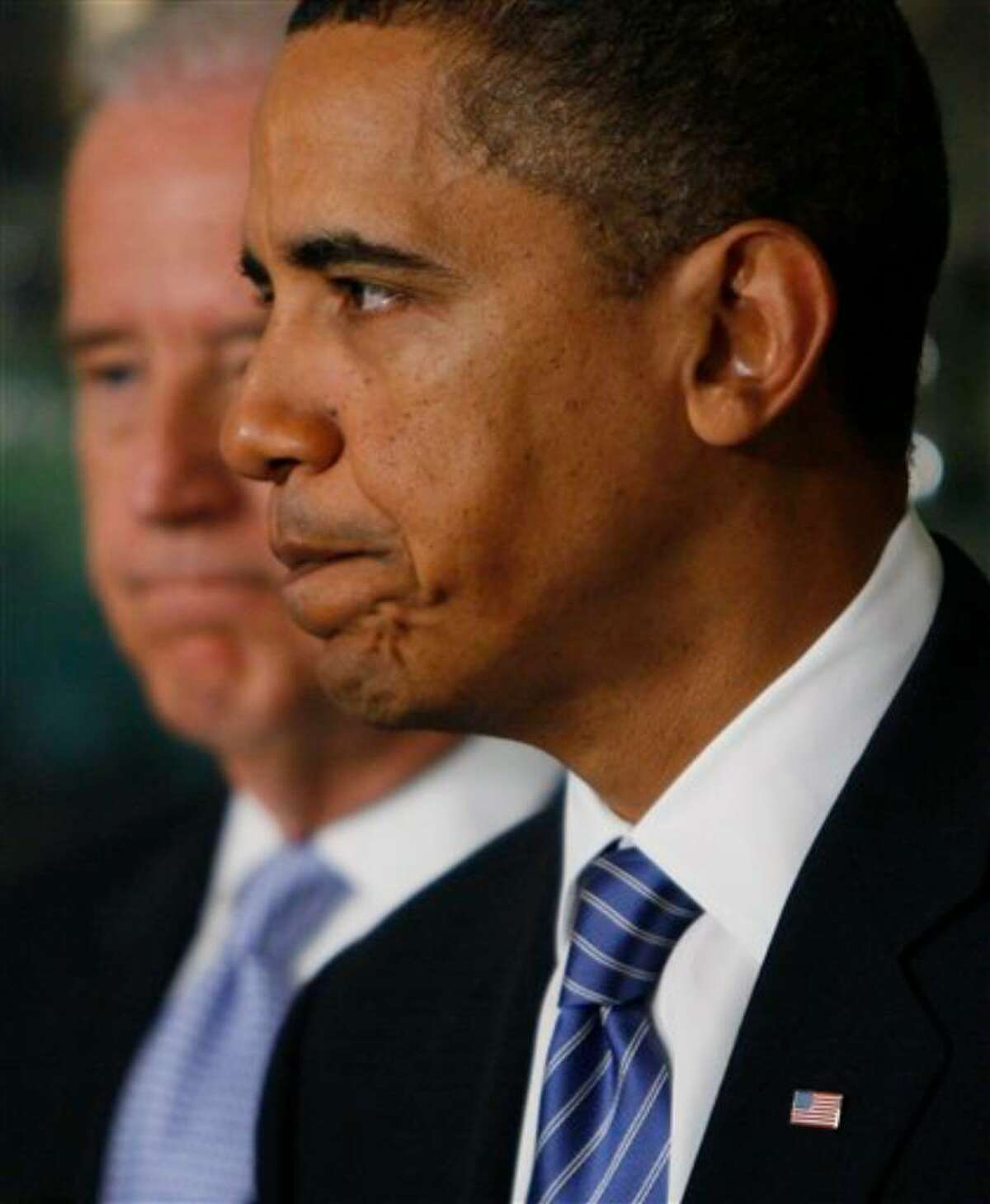 President Barack Obama stands with Vice President Joe Biden as he makes a statement about the earthquake in Haiti,Thursday, Jan. 14, 2010, at the White House in Washington. (AP Photo/Charles Dharapak)