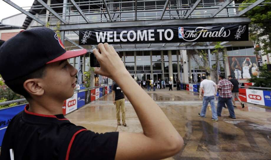 Heat fan Johnathan Andrade arrives at the AT&T Center before Game 3 of the NBA finals basketball series against the San Antonio Spurs, Tuesday, June 11, 2013, in San Antonio.