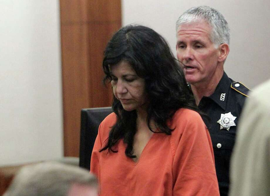 "Anna Lilia Trujillo appeared in court Tuesday in the stabbing death of her boyfriend. A prosecutor told the court she admitted hitting him ""multiple times."" Photo: James Nielsen, Staff / © 2013  Houston Chronicle"