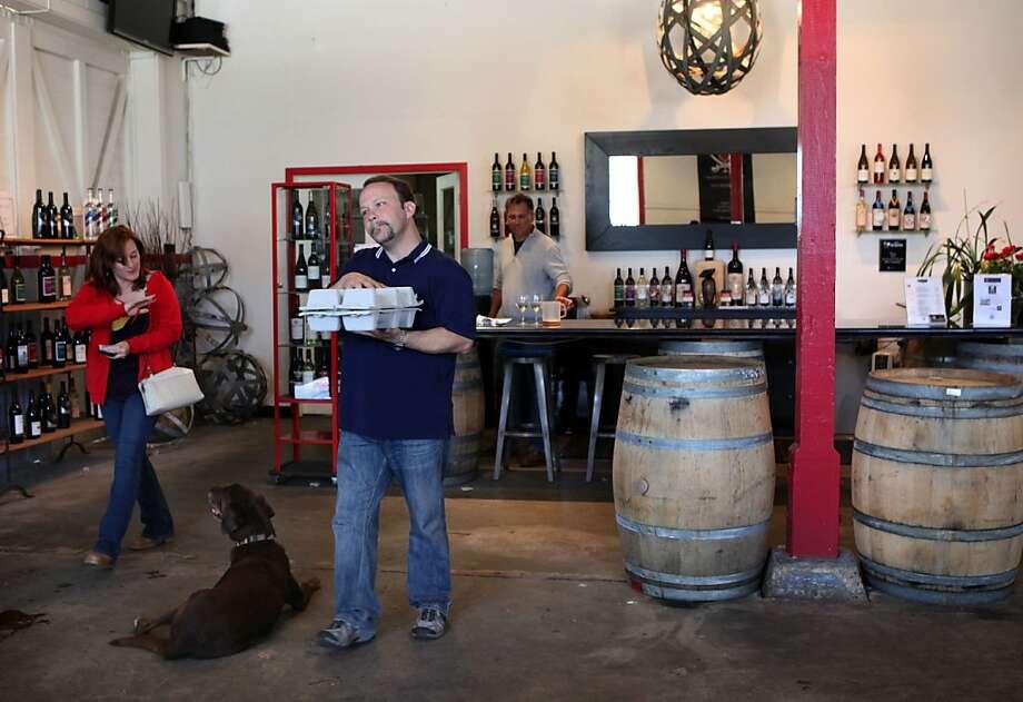Jennifer and Doug Driggers of Dallas buy bottles of Chardonnay and Merlot from Treasure Island Wines. Photo: Liz Hafalia, The Chronicle