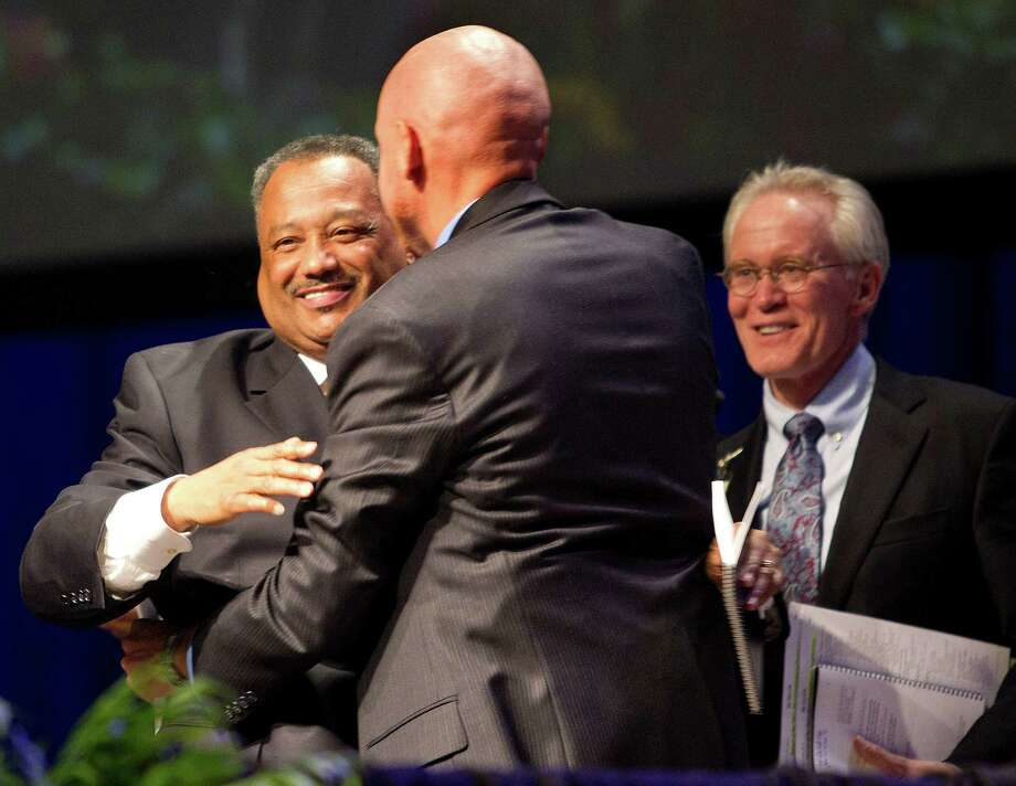 Rev. Fred Luter Jr. is congratulated after being re-elected as the Southern Baptist Convention's president during the 2013 Southern Baptist Convention Annual Meeting at the George R. Brown Convention Center Tuesday, June 11, 2013, in Houston. Luter was the SBC's first African American president. Photo: Johnny Hanson, Houston Chronicle / © 2013  Houston Chronicle