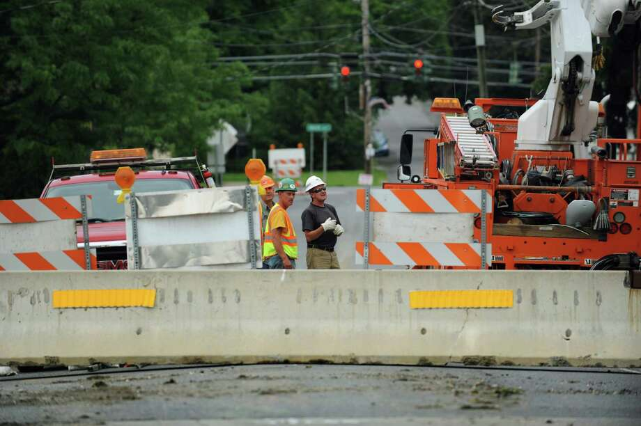 Rifenburg Construction workers look over the closed Brookside Bridge on Tuesday, June 11, 2013, in North Greenbush, N.Y. (Cindy Schultz / Times Union) Photo: Cindy Schultz / 00022714A
