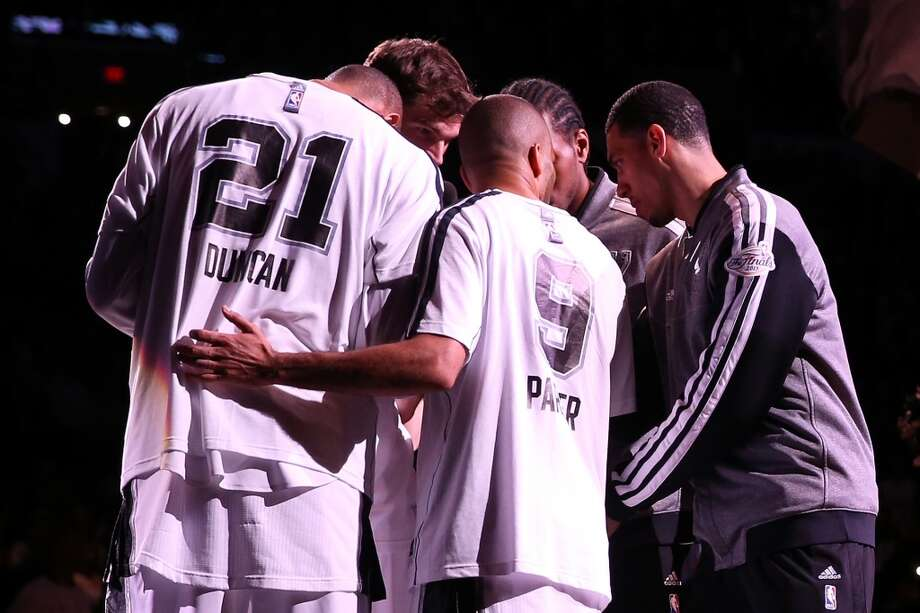 The Spurs huddle before taking on the Miami Heat in Game 3 of the 2013 NBA Finals at the AT&T Center on June 11, 2013.