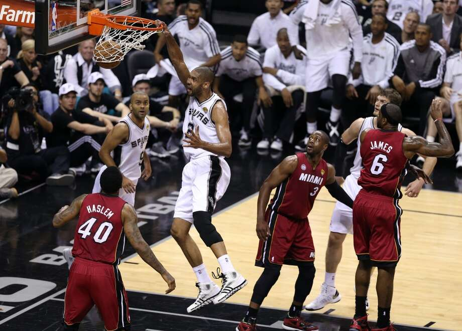 Tim Duncan 21 of the Spurs dunks the ball against Udonis Haslem 40 of the Heat in the first quarter during Game 3 of the 2013 NBA Finals at the AT&T Center on June 11, 2013.