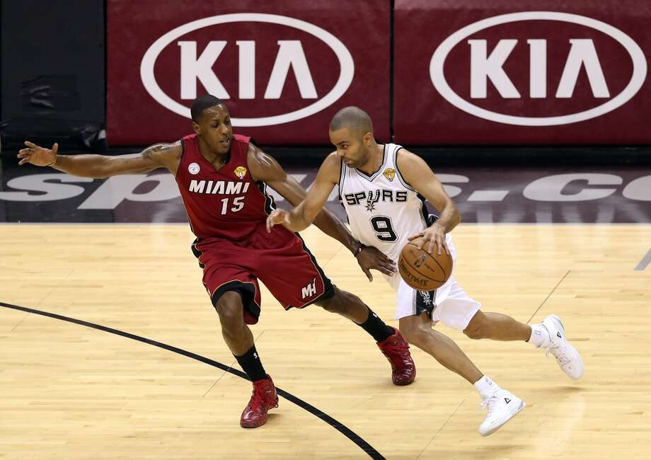 Tony Parker 9 of the Spurs drives on Mario Chalmers 15 of the Heat in the first quarter during Game 3 of the 2013 NBA Finals at the AT&T Center.