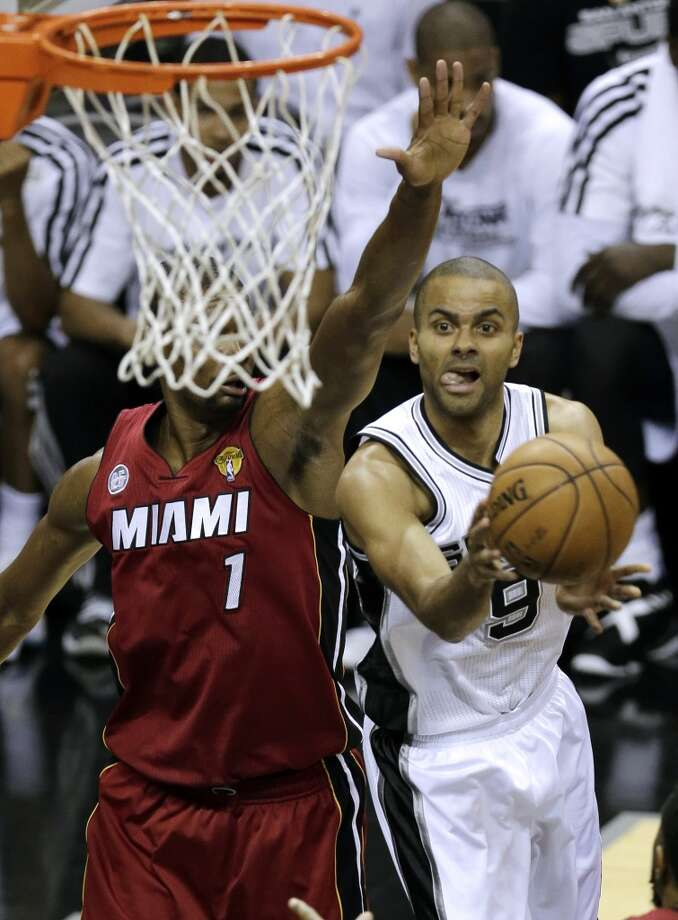 The Spurs' Tony Parker (9) shoots against Heat's Chris Bosh (1) during the first half of Game 3 in their NBA Finals basketball series, Tuesday, June 11, 2013, in San Antonio.