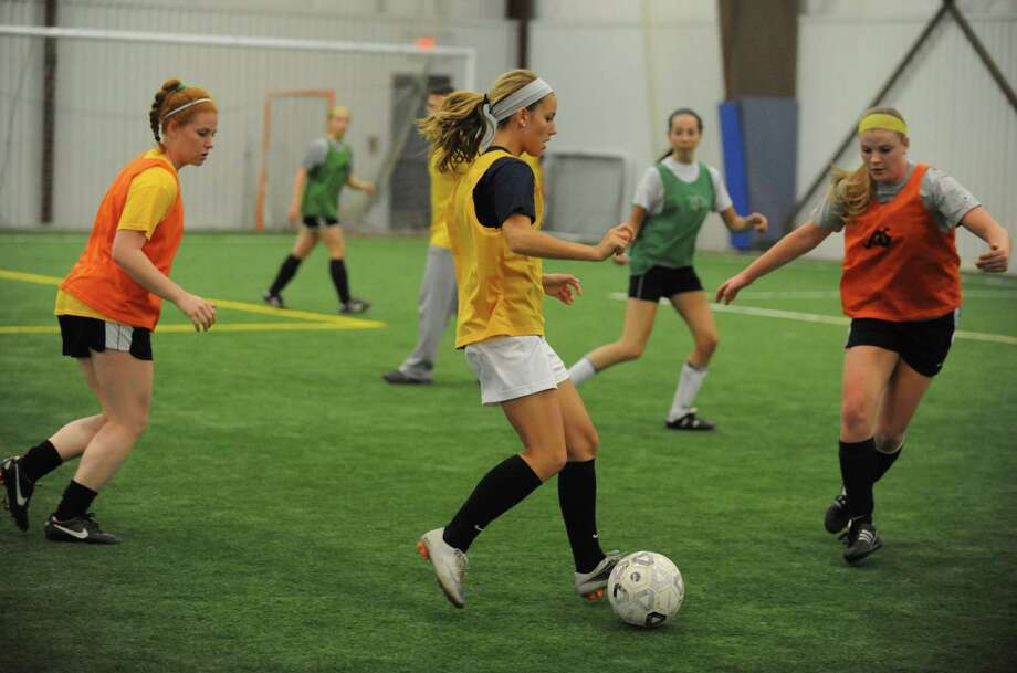 Members of the Tri-City Celtics, a new women's soccer team comprised of many former Capital Region high school and college players, practice at the Halfmoon Sportsplex on Tuesday June 11, 2013 in Clifton Park, N.Y.  (Michael P. Farrell/Times Union) Photo: Michael P. Farrell
