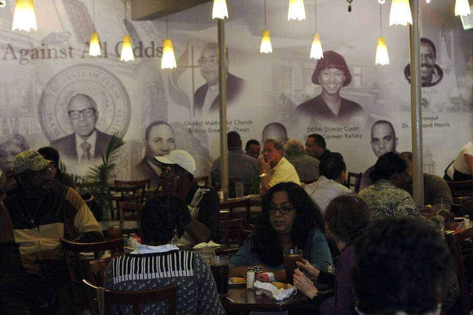 The inside of Tommy Moore's Cafe & Deli features a mural of African American community leaders. The establishment has file for Chapter 11 bankruptcy and faces possible foreclosure. Photo: San Antonio Express-News File Photo