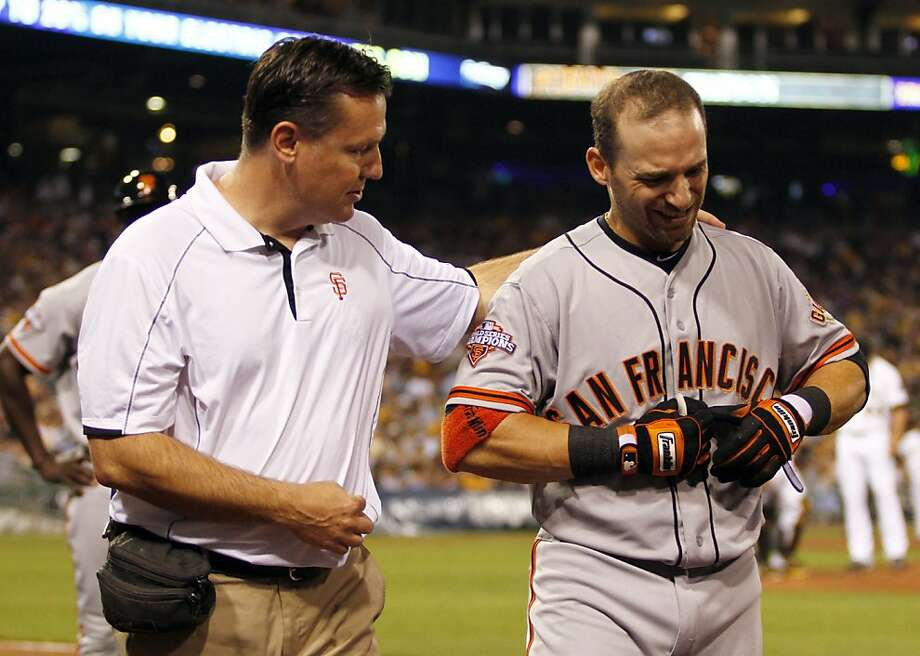 Marco Scutaro had to leave the game in the seventh after he was hit by a 94-mph fastball. Photo: Justin K. Aller, Getty Images