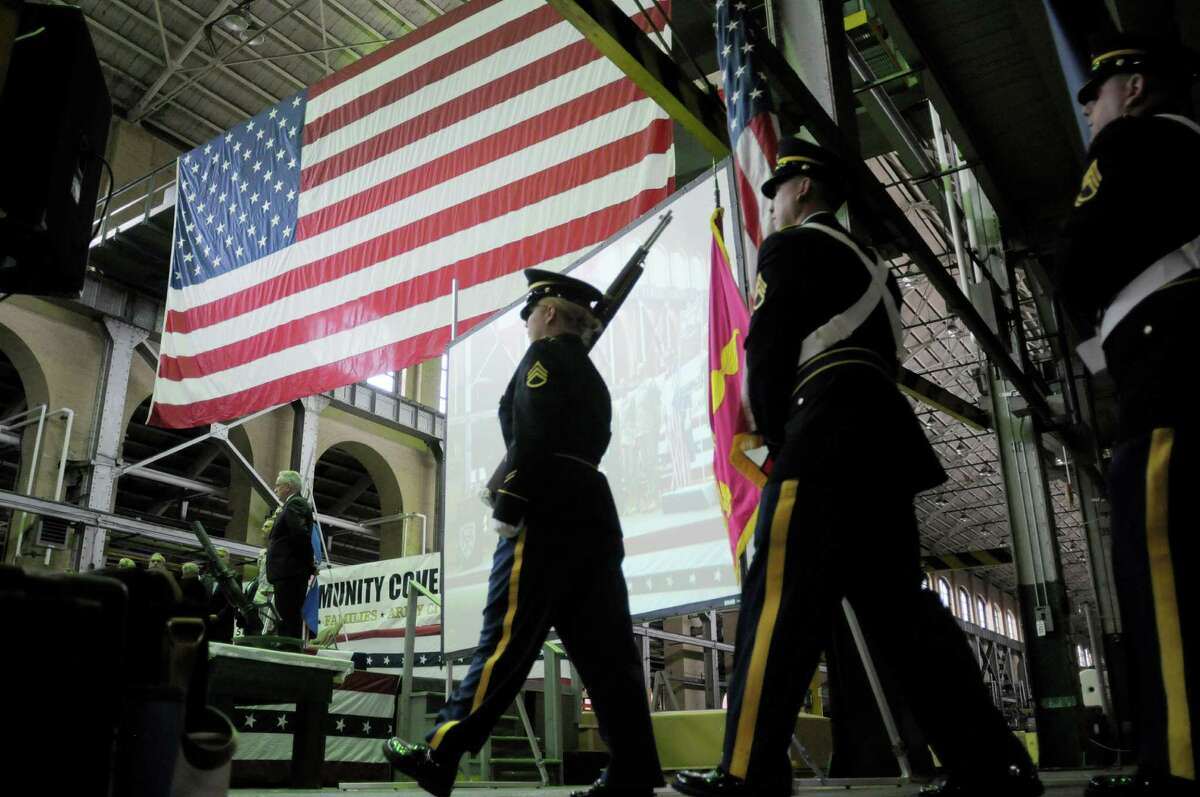 The color guard marches in with the flags during the start of the Arsenal Community Covenant Signing Ceremony at the Watervliet Arsenal on Tuesday, June 11, 2013 in Watervliet, NY. The event is designed to foster and sustain the community's partnership with the Army's Watervliet Arsenal. (Paul Buckowski / Times Union)