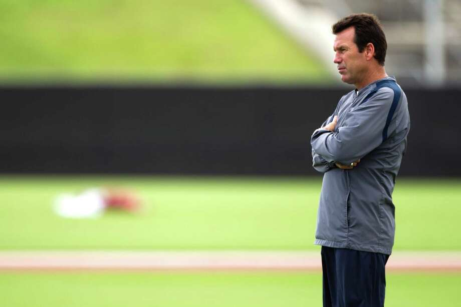 Coach Gary Kubiak surveys the scene during the Texans' first minicamp practice Monday. Photo: Brett Coomer, Staff / © 2013 Houston Chronicle