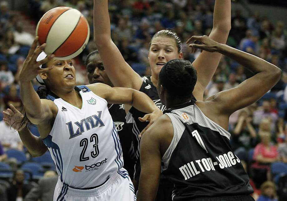 The Lynx's Maya Moore (left) tries to pass around the Silver Stars' DeLisha Milton-Jones (right). Moore, who celebrated her 24th birthday, had 19 points. Photo: Stacy Bengs / Associated Press