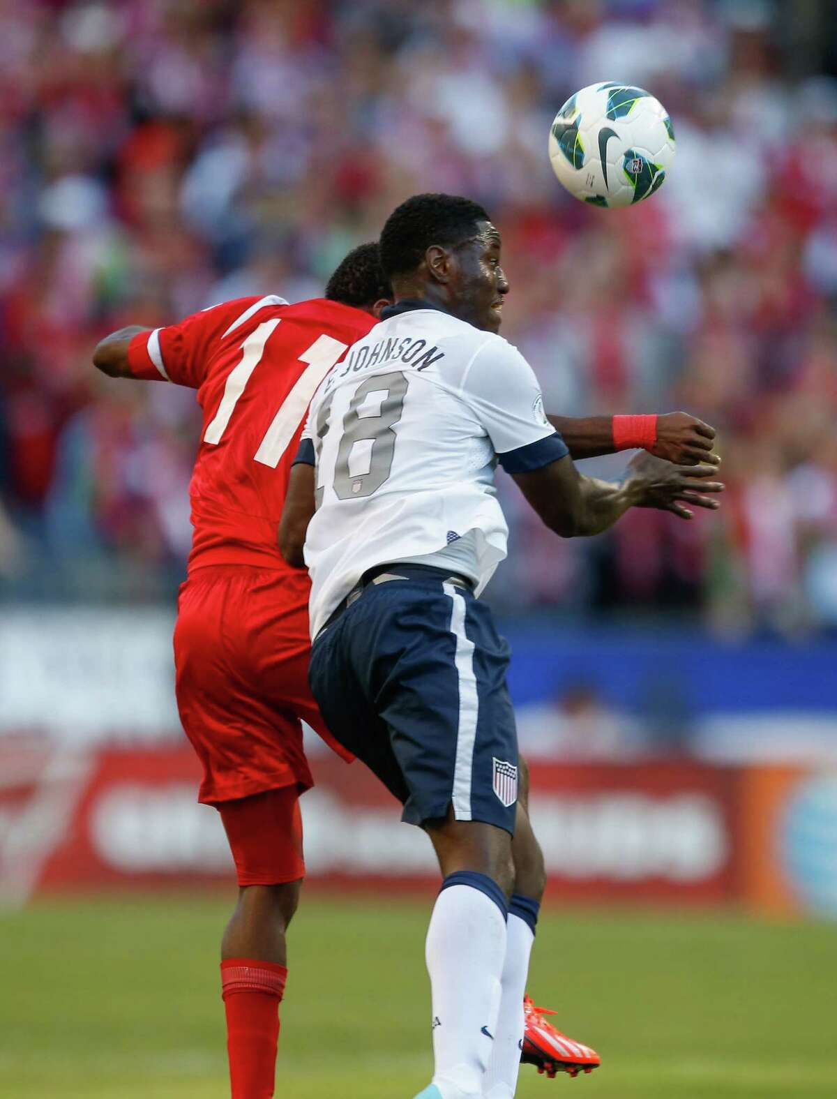 SEATTLE, WA - JUNE 11: Eddie Johnson #18 of USA heads the ball against Armando Cooper #11 of Panama during the FIFA 2014 World Cup Qualifier at CenturyLink Field on June 11, 2013 in Seattle, Washington.