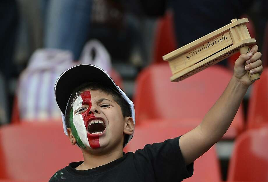 A young Mexican fan cheers for his team before their FIFA World Cup Brazil 2014 CONCACAF qualifier football match against Costa Rica at the Azteca stadium in Mexico City on June 11, 2013. AFP PHOTO/Alfredo ESTRELLAALFREDO ESTRELLA/AFP/Getty Images Photo: Alfredo Estrella, AFP/Getty Images