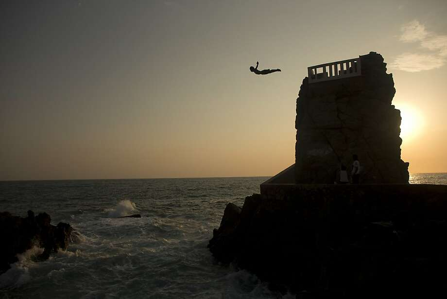 Fall guys: Hector Adrian Estrada dives off a cliff into the Pacific in Mazatlan, Mexico. Estrada 